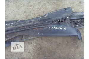 б/у Пластик под лобовое стекло Mitsubishi Lancer