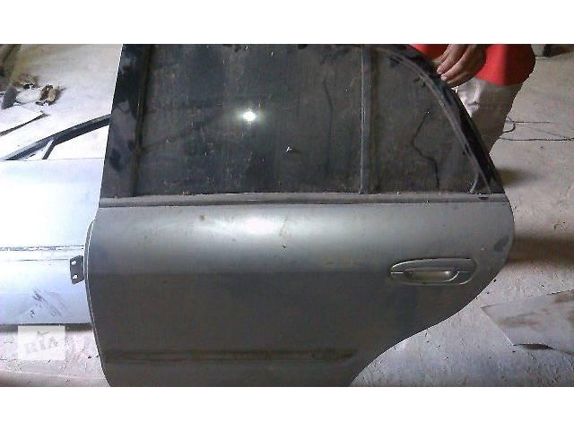 купить бу б/у Двери/багажник и компоненты Дверь задняя Легковой Mazda 626 в Ровно