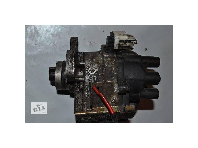 продам Б/у Электрооборудование двигателя Трамблёр Легковой Mazda 121 Q-5  1.3 бу в Ковеле