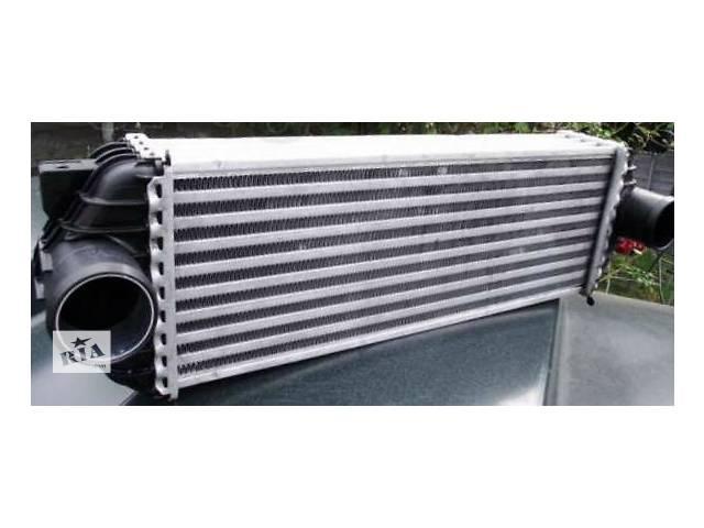 купить бу Радиатор интеркуллера Форд Транзит 2,5 TDI в хорошем состоянии в Виннице