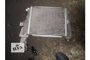б/у Радиаторы интеркуллера Mazda CX-7