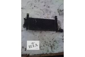 б/у Радиаторы интеркуллера Nissan Navara