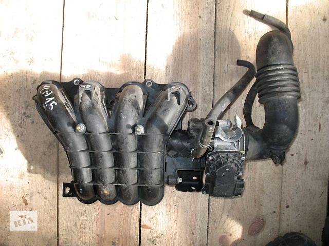 продам б/у Система впуска и выпуска Коллектор впускной Легковое авто Mitsubishi Lancer X бу в Луцке