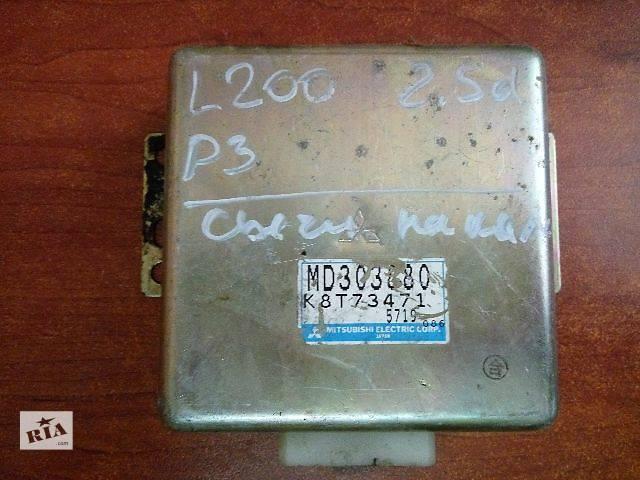 купить бу Блок управления свечами накала Mitsubishi L 200  MD303880   K8T73471 в Одессе