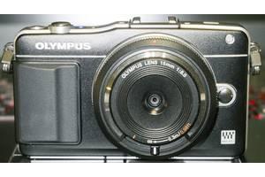 б/у Напівпрофесійні фотоапарати Olympus