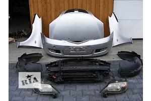 Фара Mazda 2