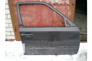Двери передние Mercedes 124