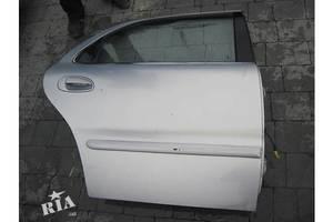 Двери задние Kia Clarus