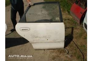Двери задние Mazda 626