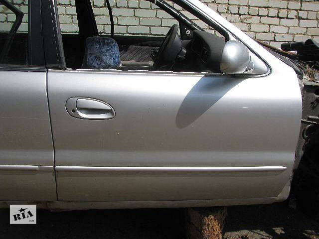 бу Двері передні праві для Kia Clarus 1998p в Львове