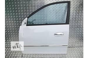 Двери передние Kia Carens