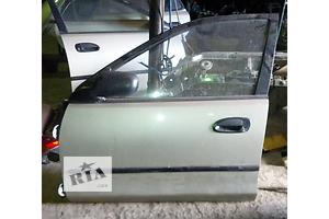 б/у Двери передние Mazda 323