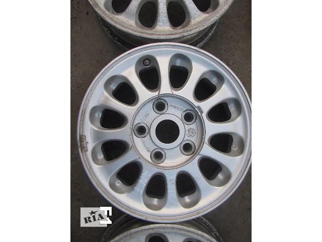 купить бу диск литой для Mazda Xedos 6 1996 R14 в Львове