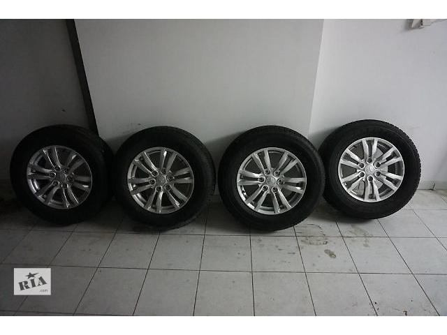 купить бу  диск с шиной для легкового авто Mitsubishi Pajero 265/60/18. в Ужгороде