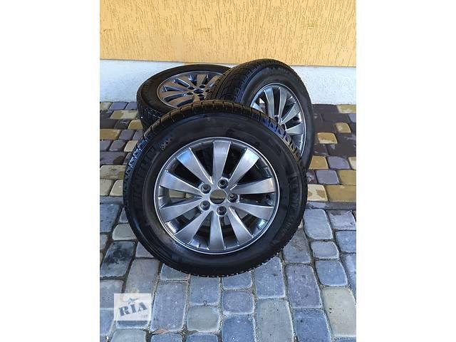 продам  Диск с шиной для легкового авто Subaru бу в Трускавце