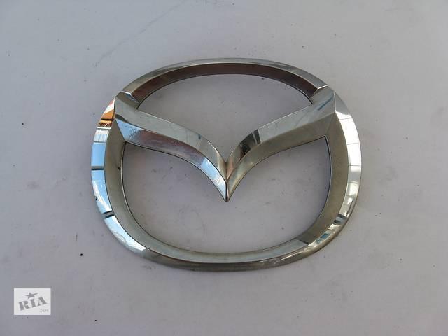 купить бу  Емблема BP4K-51-730 задня 124x98 мм для Mazda 3 Hatchback 03-09р в Львове