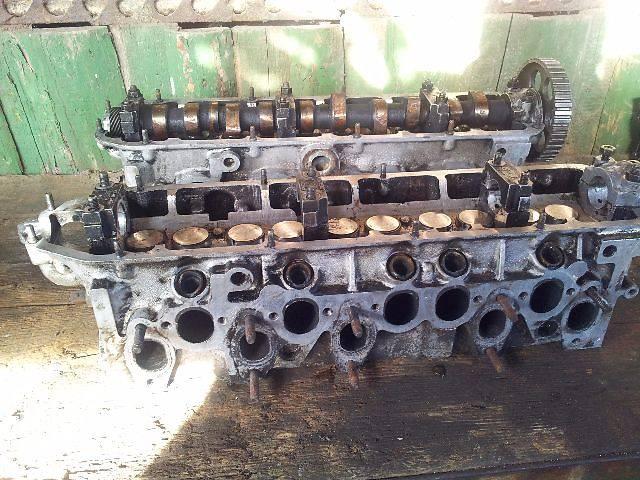 купить бу Головка блока Audi 100 1985 ауди 5 цилиндров 2,2 инжектор 2,0 карбюратор в Ровно