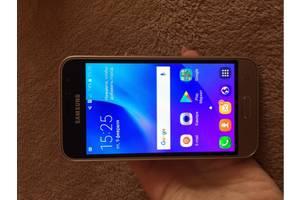 Новые Сенсорные мобильные телефоны Samsung Samsung Galaxy J1 SM-J110H/DS