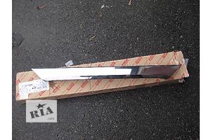 Новые Накладки двери (листва) Toyota Corolla