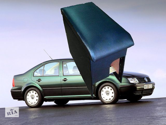 бу Новый Подлокотник на Volkswagen Boro. Мягкая и прочная крышка легко откидывается и открывает объемный бокс, который можн в Житомире