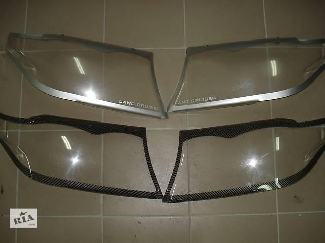 купить бу Оригинальные накладки на фары Тойота LC 200 в Харькове