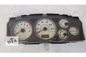 Панели приборов/спидометры/тахографы/топографы Mitsubishi Lancer