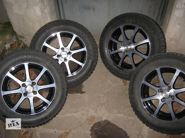 купить бу Почти новый комплект зимних колес r14 4*100 в Луганске