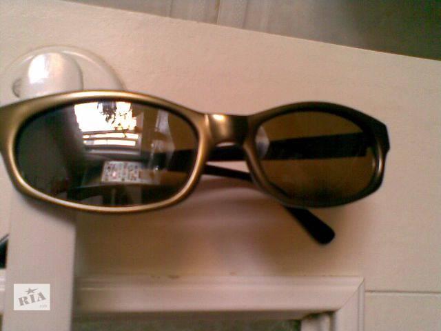 продам Солнечные очки б/у с небольшим зеркальным напылением бу в Киеве