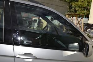 Стекла двери BMW X5