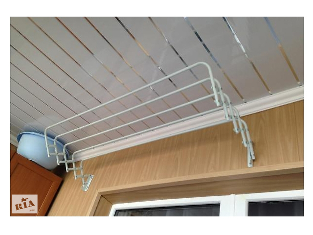 Купить балконные настенные вешала для сушки одежды..