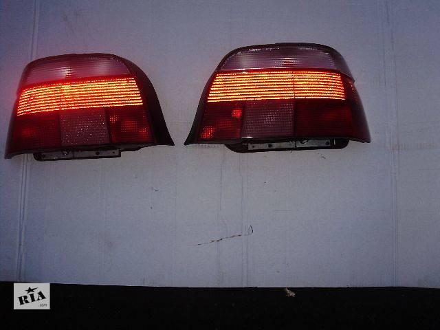 купить бу Задние фонари БМВ Е39 BMW 5 ( С белым верхом ) HELLA оригинал в Киеве