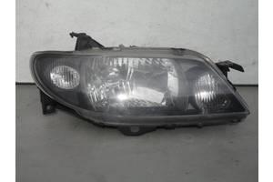 б/у Фара Mazda 323