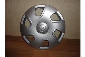 Нові Ковпаки на диск Skoda Rapid