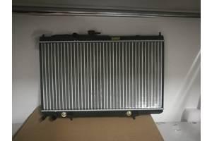 радіатори Nissan Almera Classic