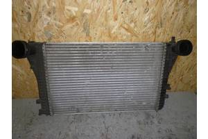 б/у Радиатор интеркуллера Volkswagen Caddy