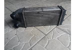 б/у Радиатор интеркуллера Peugeot Partner груз.