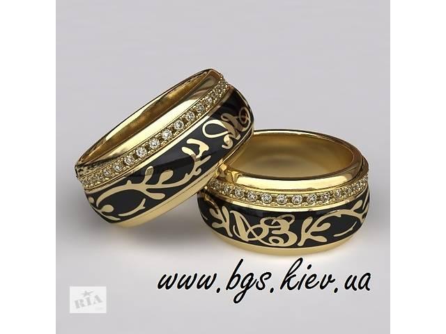 продам Золотые обручальные кольца с камнями   бу в Киеве