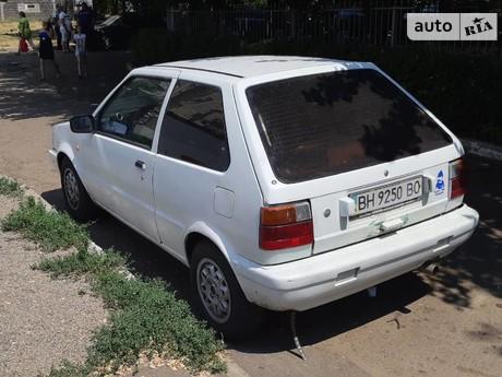 Nissan Micra 1.2 MТ (76 л.с.) 1989