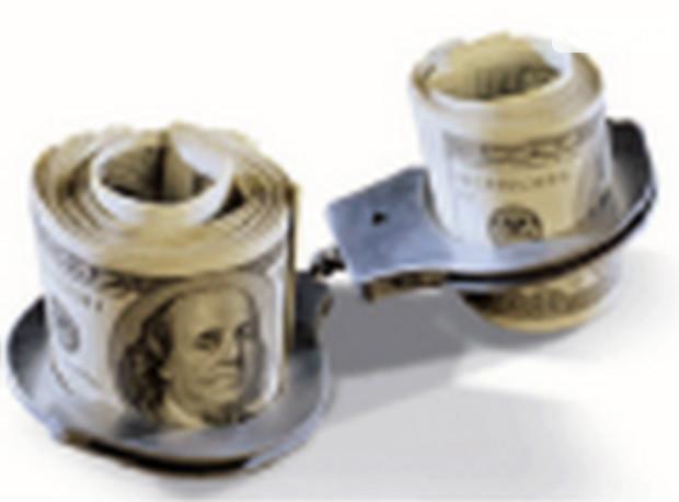 За снижение стоимости нежилого помещения чиновники требовали взятку в размере 40 тыс. долл. США
